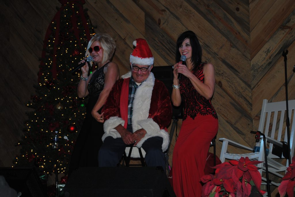 "The girls sing ""Santa Baby"" to Adrian."